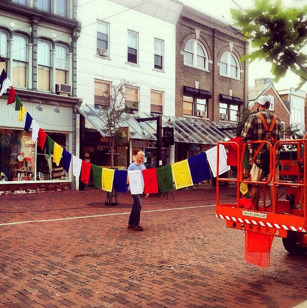 Prayer Flags Going Up for Yoga on Church Street